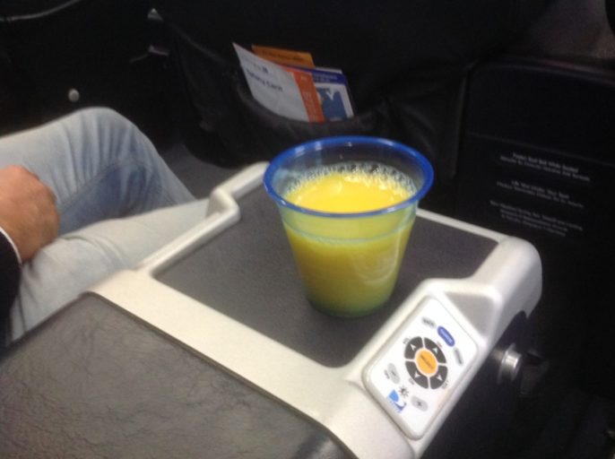 United Airlines Business Class, jus d'orange voor het opstijgen