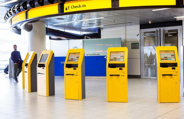 schiphol self service check in kiosk