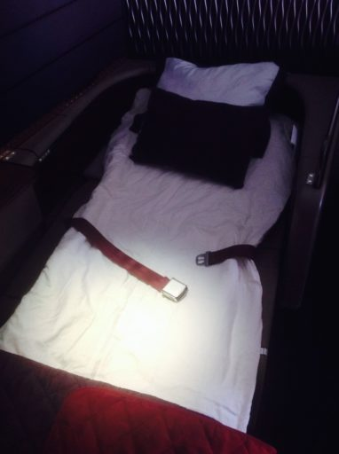 qatar airways, first class, bed
